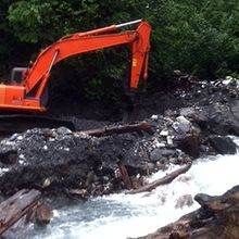 excavator in creek